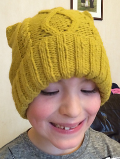 Knitting Pattern For T Bag Hat : Ravelry: T-Bag Cabled Hat pattern by Sirdar Spinning Ltd.