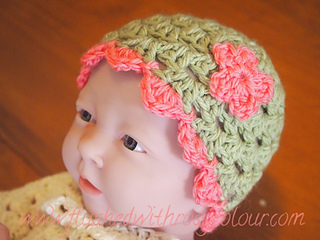Baby_doll_wearing_pink_green_hat_small2
