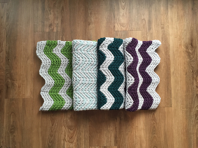 hand knitted blanket with chevron patterns
