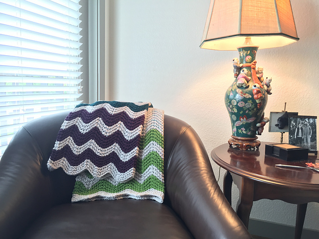 chevron knit blanket laid over a chair