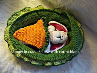 534_bunny_in_cradle_with_carrot_blanket_on_small2