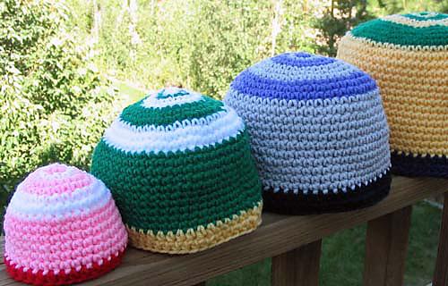 Festive_hats_crochet_on_rail_medium