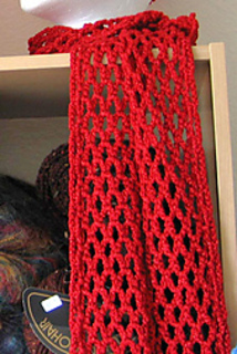 Liquid_gold_red_scarf_on_shelf_1_small2