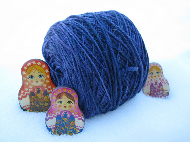 Yarn in snow with Matryoshka dolls