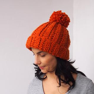 Knit look bulky hat with pom pom pattern by Ana D