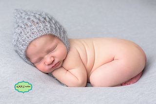 c84a99b26be Ravelry  Newborn Puff Pixie Hat pattern by Amanda Kuhn