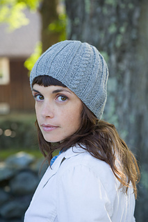 423a850759f Ravelry  Adelaide Cable and Rib Hat pattern by Classic Elite