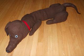 Dachshund Draft Stopper By Golden Press. © Glenda