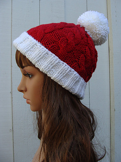 05522298efade Ravelry  Cable Santa Pom-pom Beanie with fold up brim pattern by Mary Legere