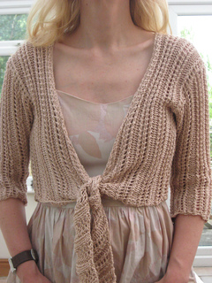 c06a3c3e1 Ravelry  Design H - Lace Tie-front Bolero pattern by Sirdar Spinning Ltd.