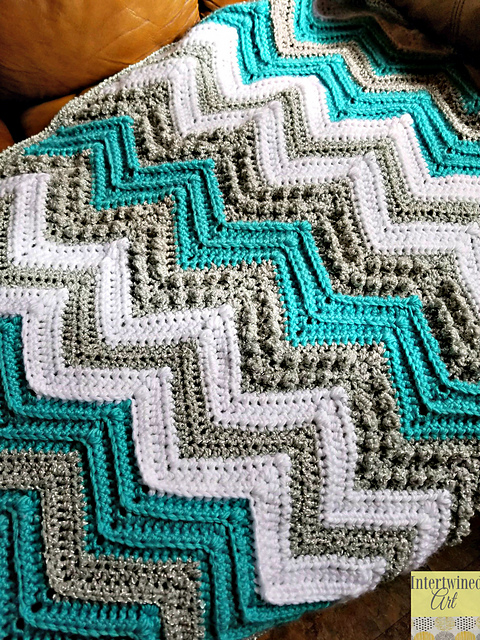 Ravelry Tons Of Texture Chevron Baby Blanket Pattern By Intertwined Art