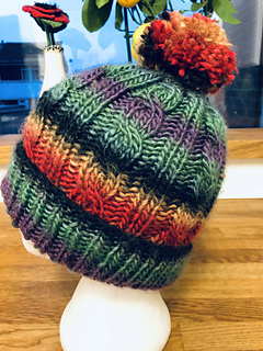 Ravelry  Easy Peasy Cable Hat pattern by Caroline Spillane c6c54884c59