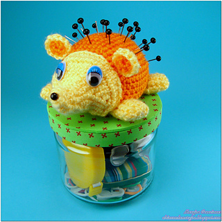 http://www.ravelry.com/patterns/library/hedgehog-pincushion-vessel