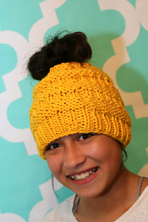 Ravelry  Messy Bun Hat pattern by Isela Phelps 6746cc01c76