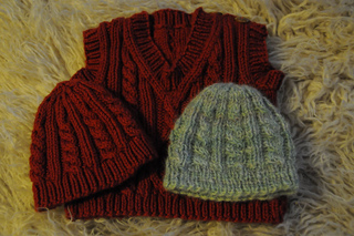 Ravelry  Cabled Baby Hat pattern by Amy Shannon 5870955a96d9