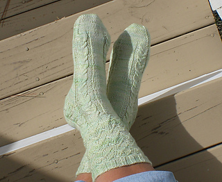 Delaney_tlks_to_statues_feet_crossed_medium2_small2