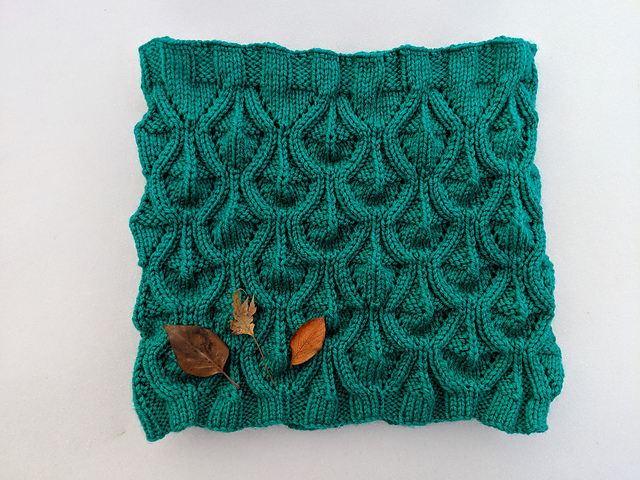 Nose Hill Park Cowl in green aran weight yarn.