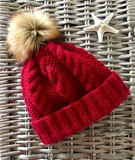 adf8b10f4a5 Ravelry  Ladies Aran Cable Hat with Pom Pom pattern by Rhona Larkin