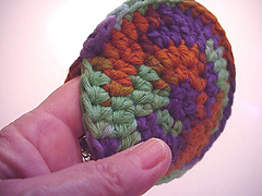 Azteccrochetedsnugglepuffwhand1_small