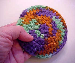 Azteccrochetedsnugglepuffwhand_small2