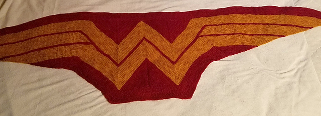 Wonder Woman red and gold shawl, stretched out for blocking