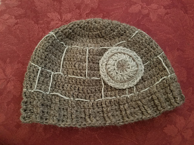 Grey crochet hat embroidered to look like the Death Star