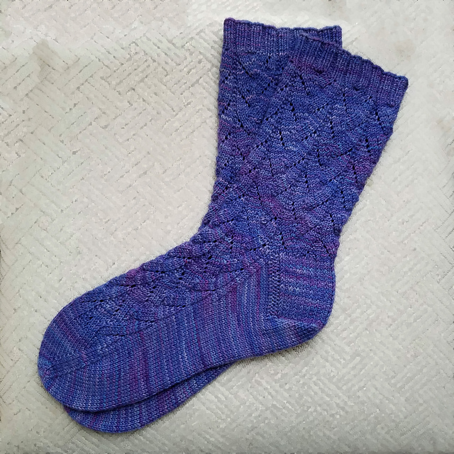 Blue knit socks with a diagonal lace pattern