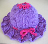 Bell_ruffle_toddler_hat_on_table_small_best_fit