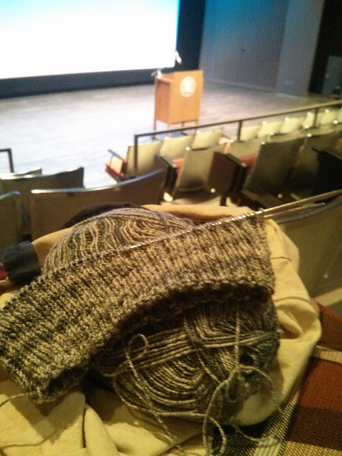 Unfinished hat and ball of yarn