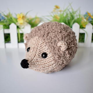 Small Hedgehog Knitting Pattern : Ravelry: Snuggly Hedgehog pattern by Amanda Berry
