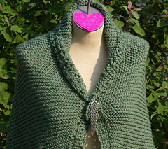 Hex_green_durable_shawl_style_pinned_in_front_points_hanging_small