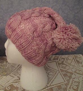 c64880c7cc4a Ravelry  ROSADA Cabled Hat pattern by Karen Walker