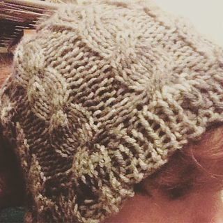 Ravelry  Cabled Messy Bun Hat pattern by Andrea Collins 6601db3c8c4