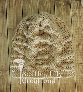 0dc87eeaa81 Ravelry  Cables and Puffs Slouch Hat pattern by Jamie Huisman