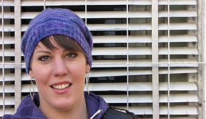 Purple-hat-farther-away-looking-at-camera-smile-low-res_small_best_fit