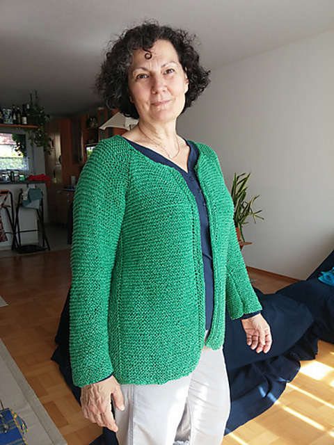 The gorgeous Mirella, modelling her sample knit of the Aline Modular Cardigan pattern in a cool green.