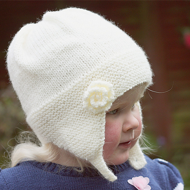 85f1e19e216 Ravelry  Charlotte - Earflap Hat with Rose Flower pattern by Julie ...