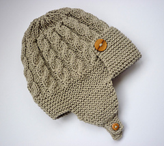 1a59b712bf9 Ravelry  Dayton - Cabled Baby Aviator Hat pattern by Julie Taylor