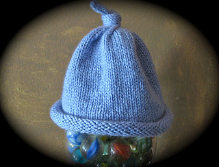 Ravelry  Rolled Brim Baby Hat with a Topknot pattern by Laurie Longinotti c7b25228498c