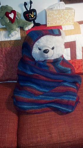 teddy bear wrapped up in shawl
