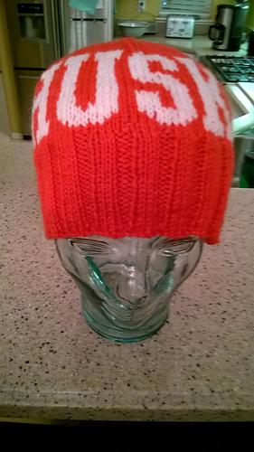 93ea7da271f Ravelry  University of Nebraska Button Beanie Kit pattern by Melanie ...