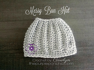 Messy_bun_hat_on_the_purple_poncho_small2